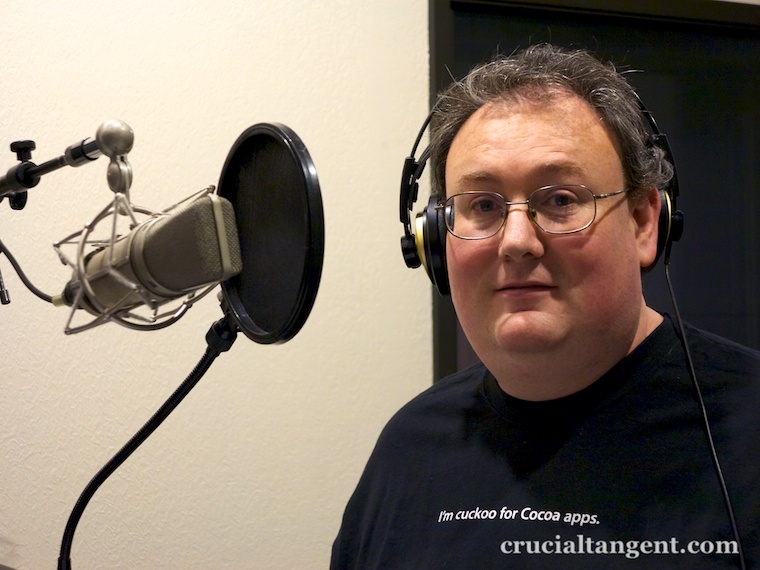 "James Dempsey at the microphone wearing ""I'm cuckoo for Cocoa Apps"" t-shirt"