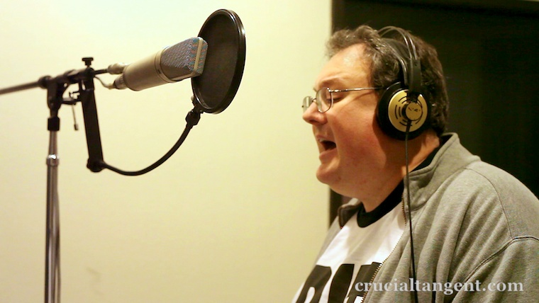 James Dempsey singing into a microphone