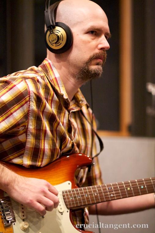 John Scalo playing electric guitar