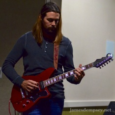 Rusty Zarse playing electric guitar