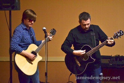 Jonathan Penn and Ben Scheirman playing acoustic guitars