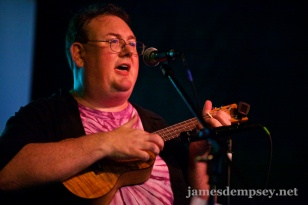 James Dempsey singing and playing ukulele