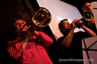 Sam Davies playing trombone and Daniel Pasco playing trumpet