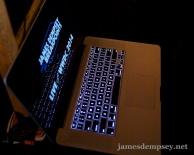 MacBook Pro with LIVE near WWDC 2014 Logo on screen