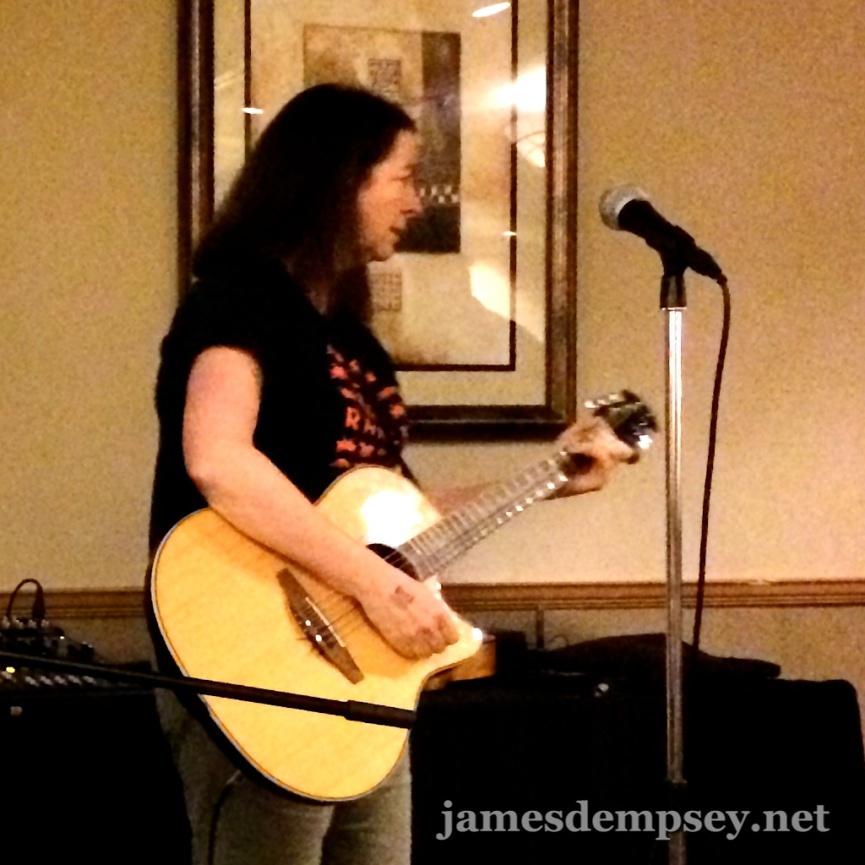 Jean MacDonald playing acoustic guitar